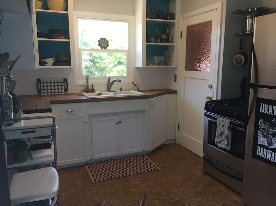 Kitchen is in an open floor plan from living room: gas range, blender, juicer, etc. Please note no dishwasher or microwave.