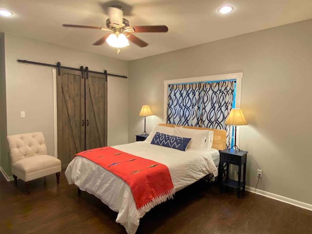 A large private primary suite with a new very comfortable queen bed with all new bedding.  Two large closets provide plenty of room for you clothes and traveling gear. The adjoining bathroom is great with a large shower to wash away the days fun.