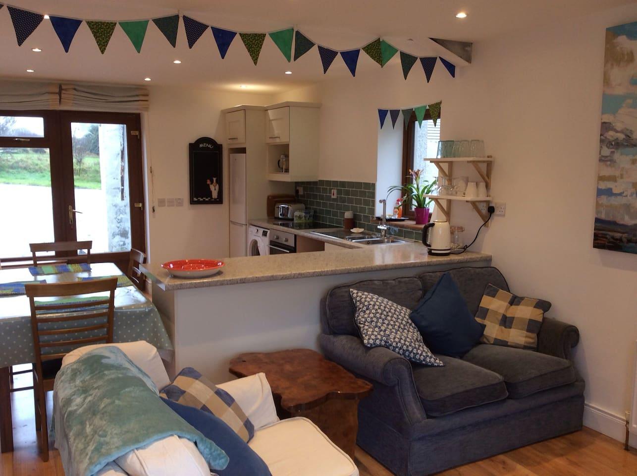 Open plan kitchen,studio and sitting area.