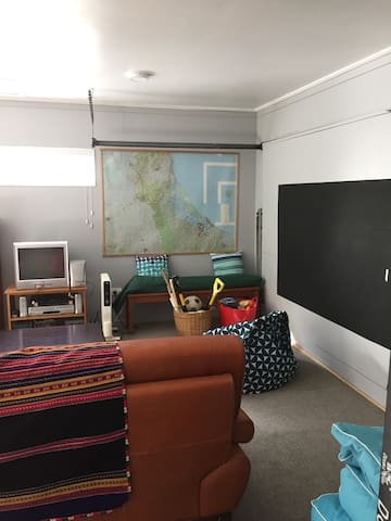 The Den - Bunkroom.  Opens to the backyard.  Seperate area for children and teenagers.   Bunks..........DVD, Video, Games,  Blackboard, Table Tennis table