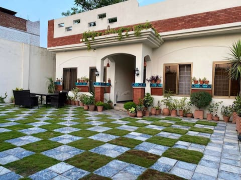 Gest house of 3 bed 9000pkr per room
