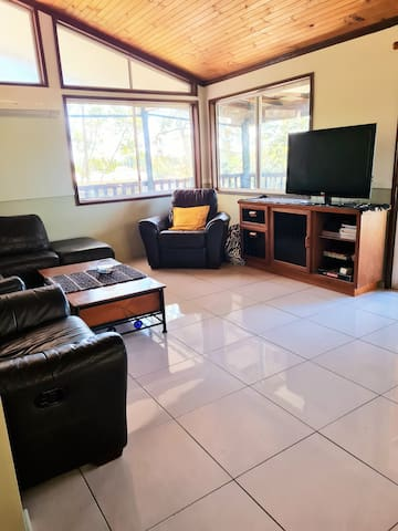 Large airy, open plan lounge room. Recliners add comfort. Games, eg Cluedo, card games, Monopoly, Scrabble, 20+ others, outdoor games. Books on a range of topics. TV, roku, Netflix,wifi and VCR. Hundreds of DVDs by arrangement.Childrens Dress up.