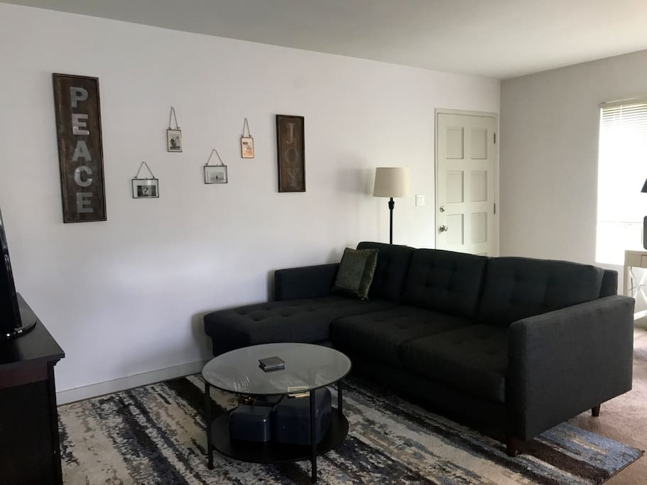 Living room with comfortable couch (room for one to sleep), HD Smart TV with Netflix, Hulu and HBO GO.