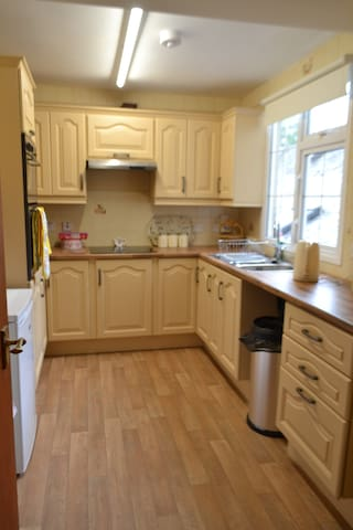 Newly renovated kitchen with all the amenities you'll need; hob, oven, fridge, kettle (tea and coffee provided), pots and pans.