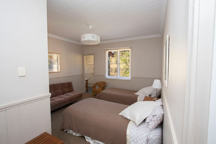 A very comfortable second bedroom with 2 king single beds and a fold down lounge bed. A bathroom adjoins.