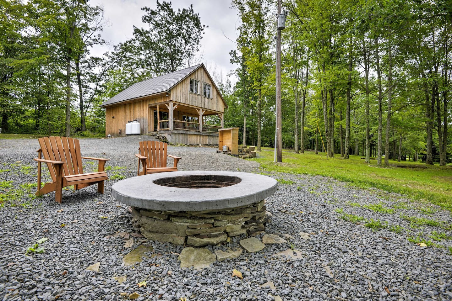 Tell campfire stories and roast marshmallows by the fire pit during your stay at this 2-bedroom, 1.5-bathroom vacation rental cabin in Ulster!