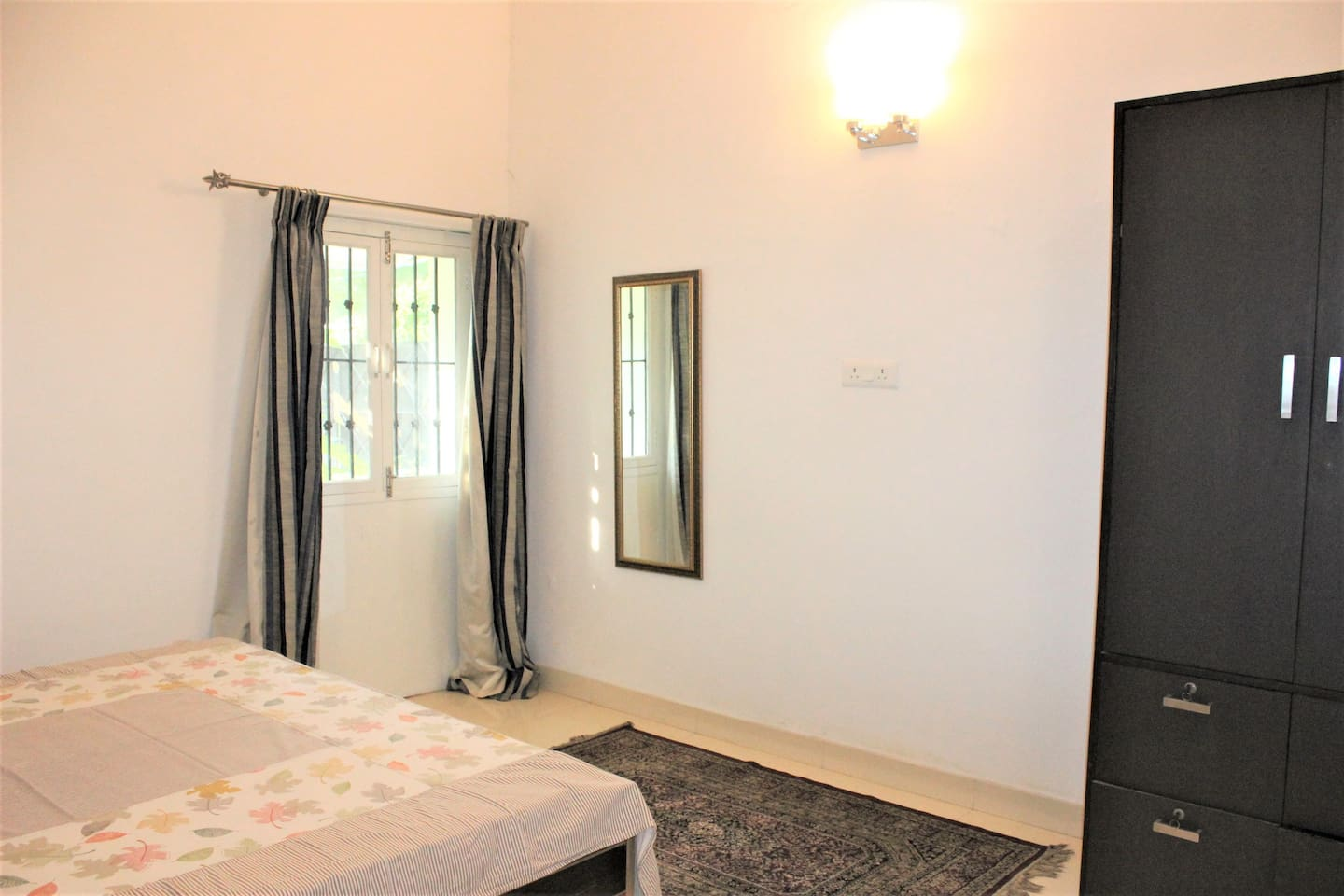 Bedroom with a double bed ( a comfortable mattress, pillows and a comforter) Big enough wardrobe for two people