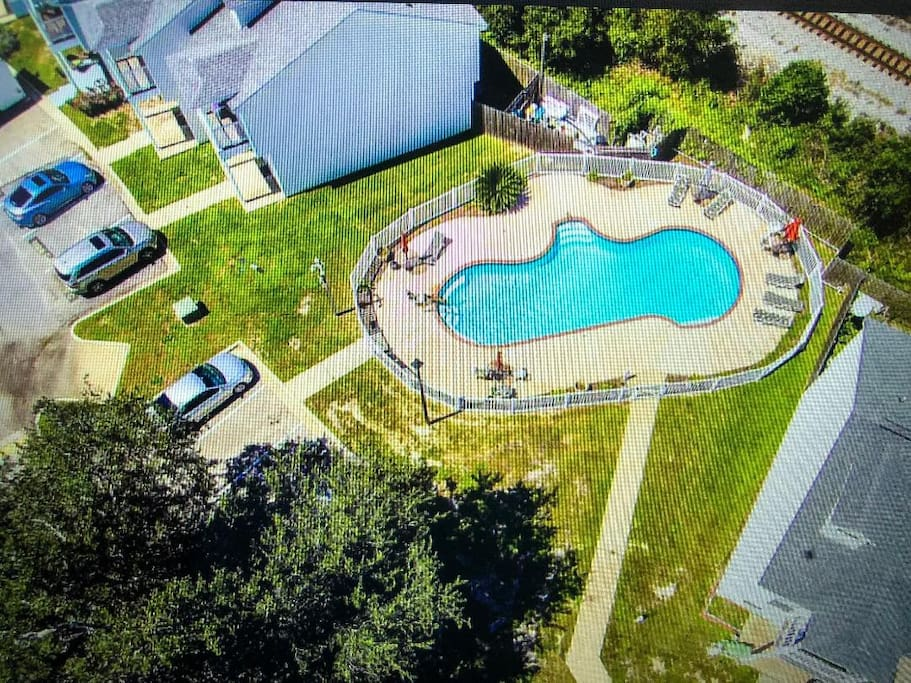 Air view of our private pool on property, new lawn furniture, tables with umbrellas, always kept VERY clean our unit is just about 8 doors from pool
