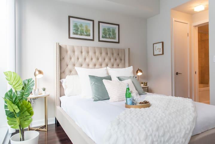 Bedroom featuring a cozy queen bed
