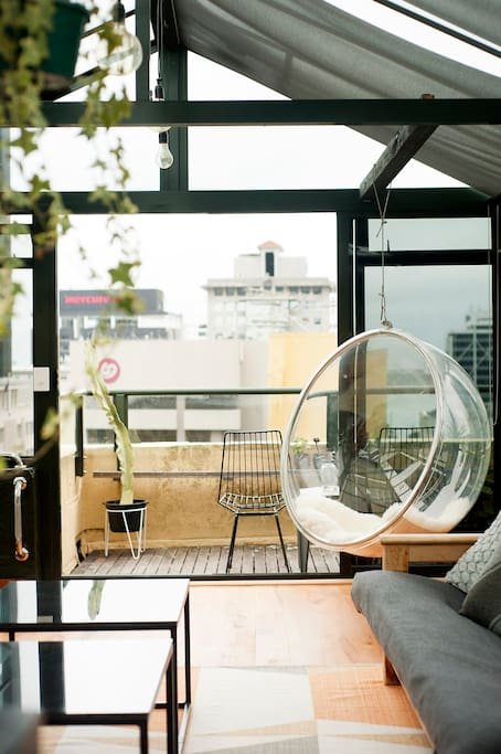 rooftop conservatory living area - views out to the harbour