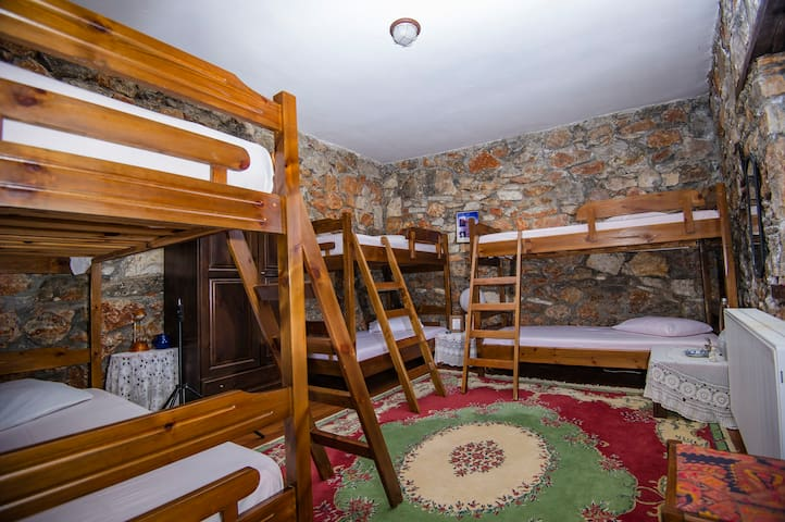 Stonewalls inside and wooden dormitories