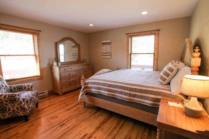 This room is on the main level and has a king size bed, flat screen TV and full dresser and closet.  Great views too.