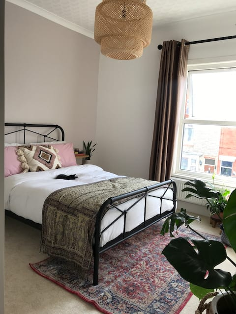 Pretty boho style room in terraced house