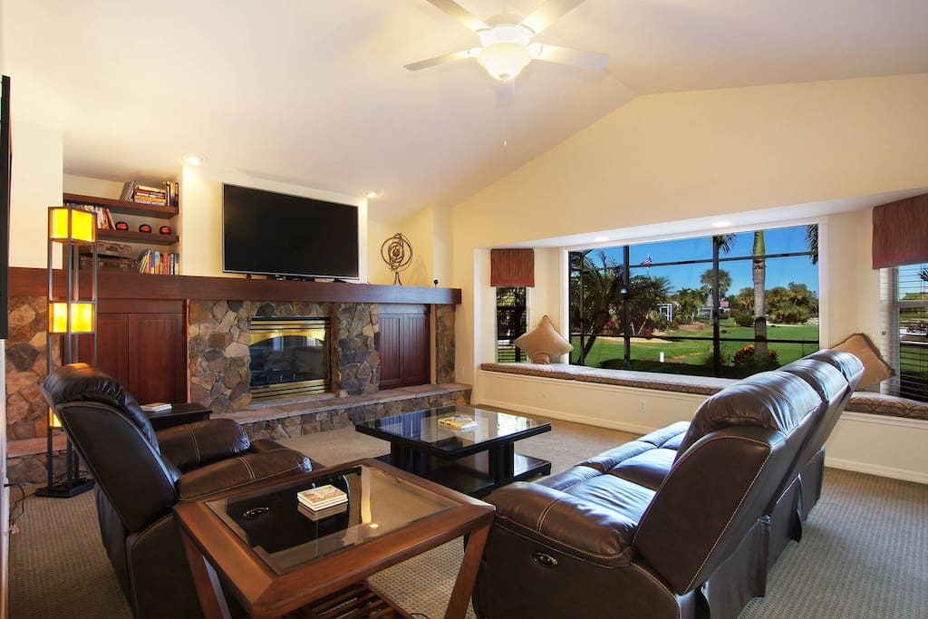 Family Room with fireplace and golf course view