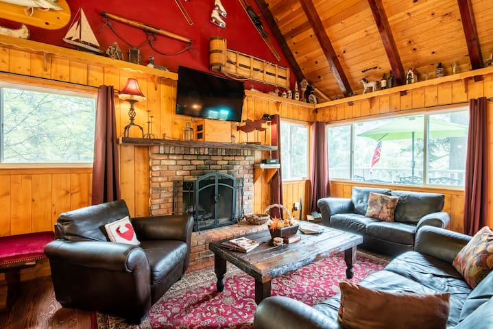 "Tyler said, ""Incredible cabin! 3 levels of a luxurious rustic cabin experience. 2 fireplaces. Awesome grills. Great place to cook/grill. Convenient to everything (few min walk to lakeside). Cindy is so accommodating and hospitable! Will def be back!"
