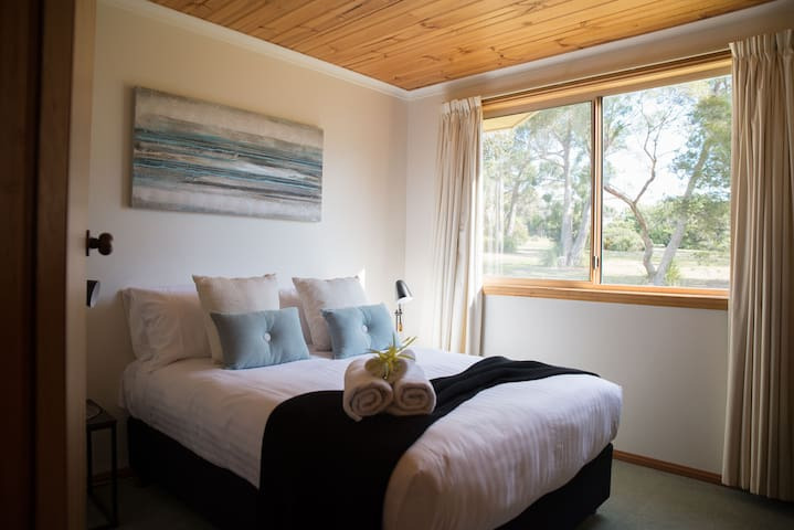 Double bedroom with bush views