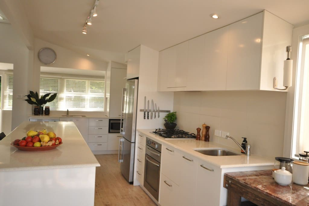 Gourmet kitchen with dual food prep / washing stations and free standing island