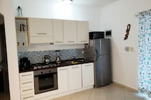 All equipped kitchen with gaz stove, electric oven, microwave, utensils, etc