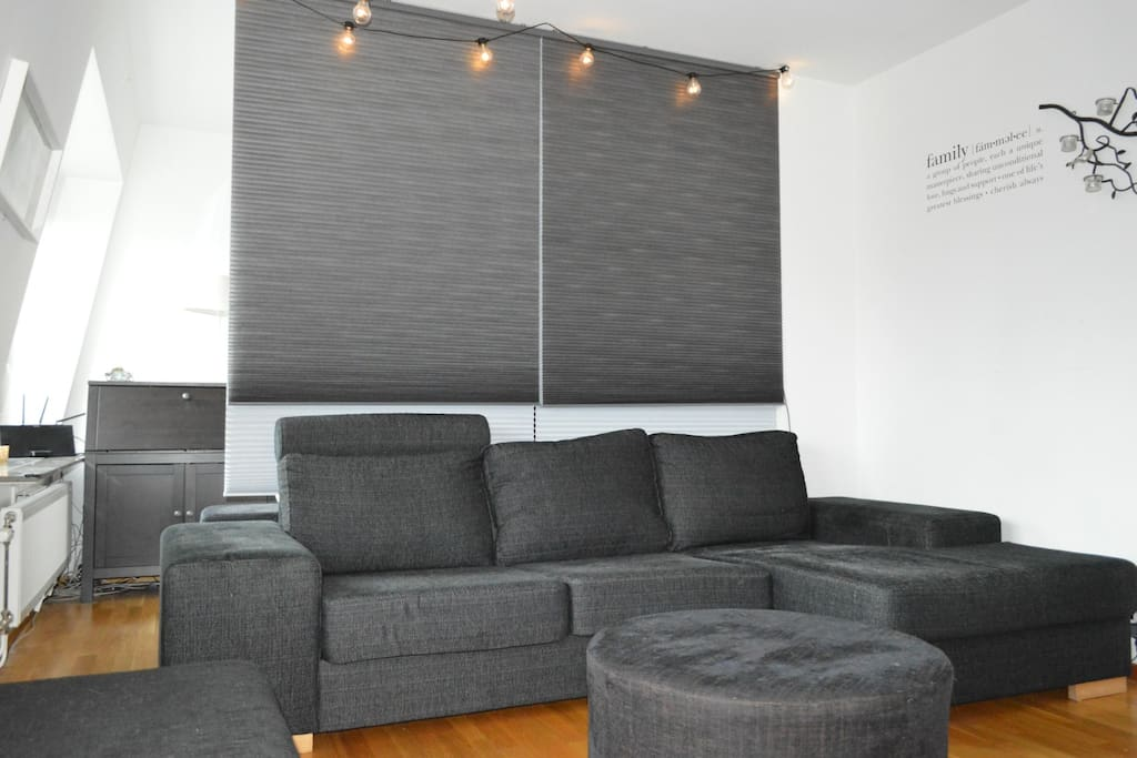 The apartment's living room is large and therefore divided into two spaces. The part that is a living room has a large sofa and a large flat screen-TV. The sofa is very comfortable to sleep in. Two people have even slept in it at the same time, but that is however not so comfortable.