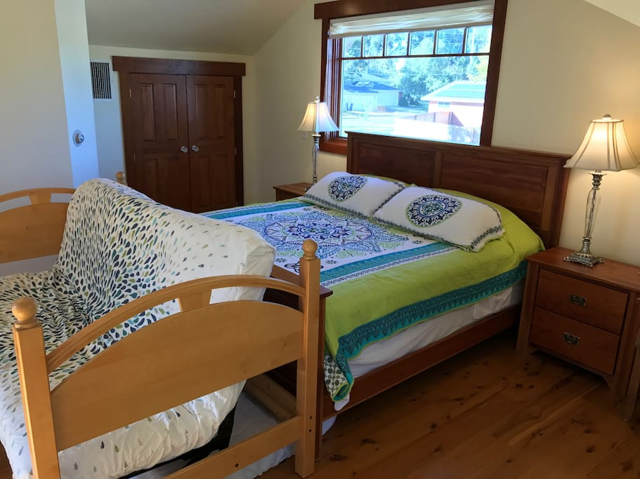 A King size bed and futon couch that converts to a double bed