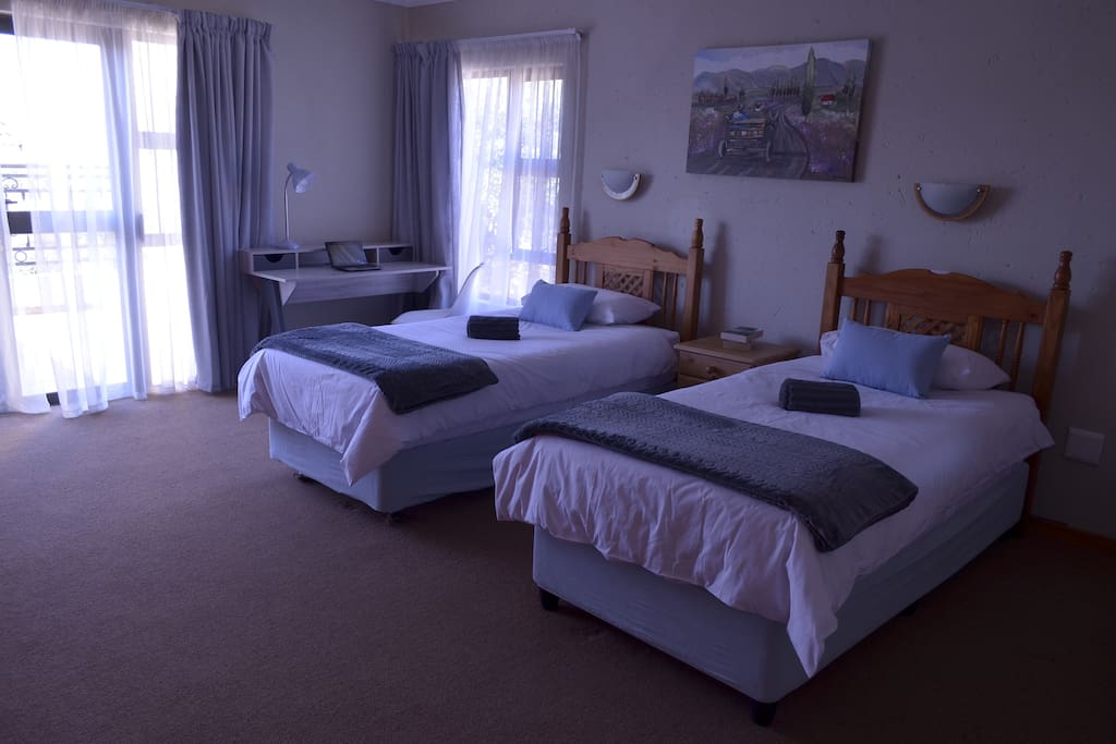 Room 1 with two single beds