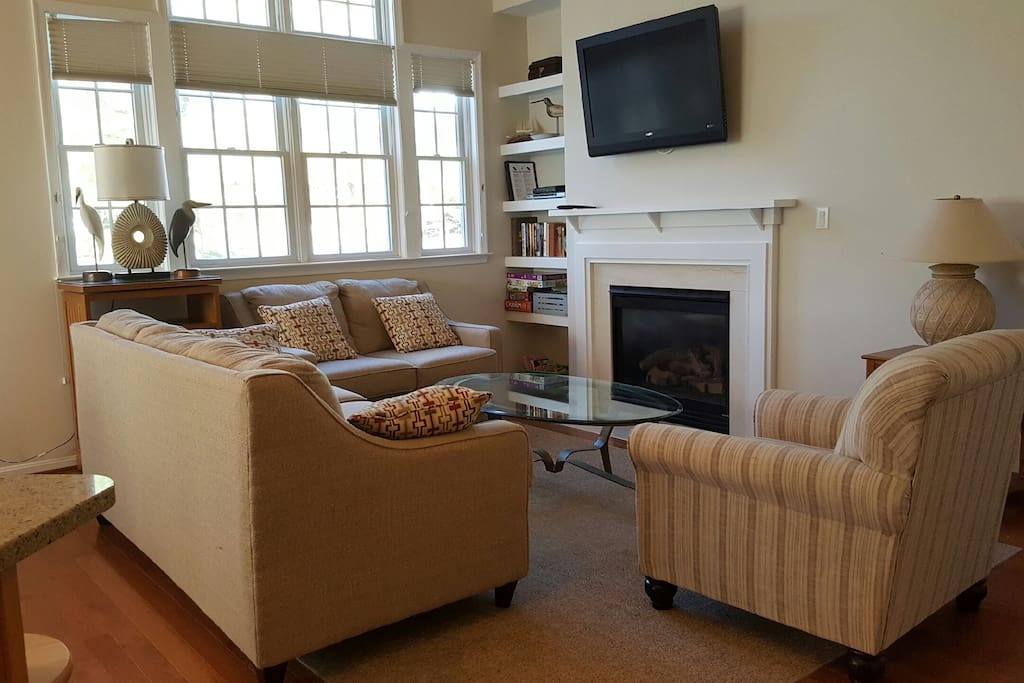 Living room with flat screen TV and ample seating