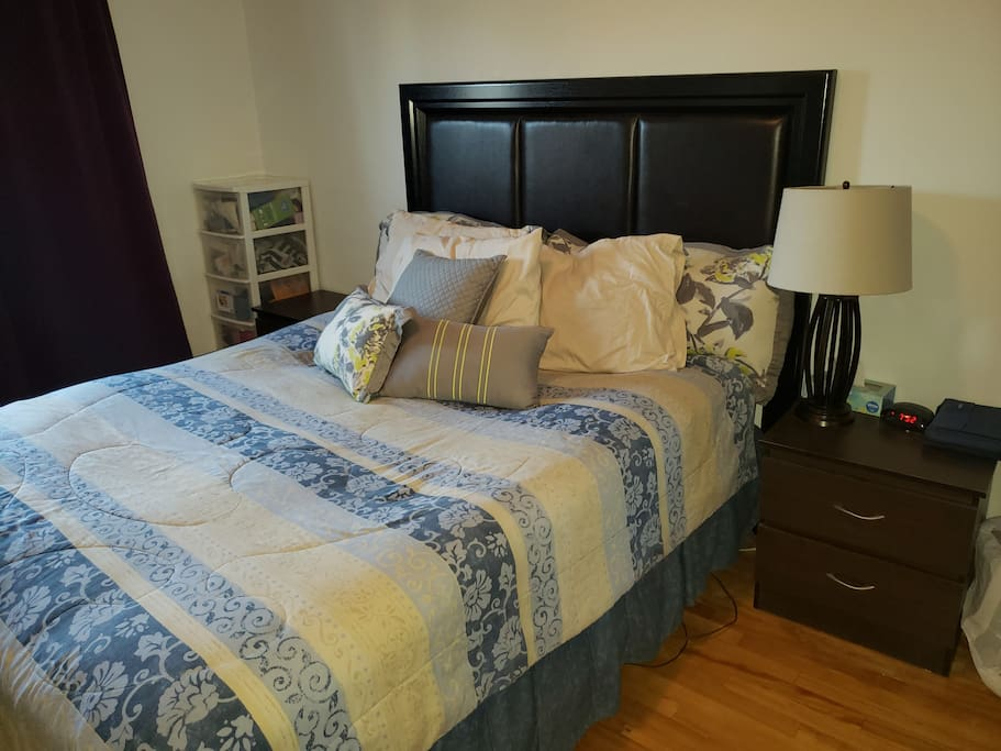 Queen size bed with A/C in room