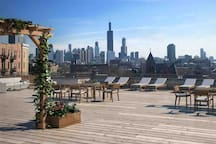 Massive roof deck with skyline views and luxury outdoor furniture