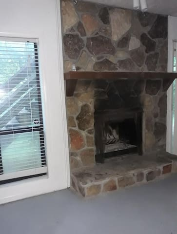 Stone fireplace-Perfect place to relax and warm up on a cold winter night.