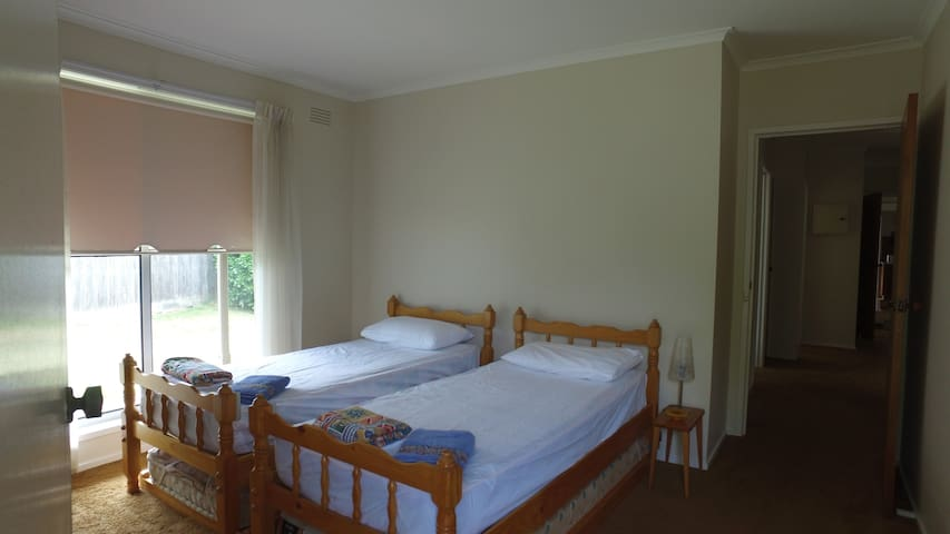 Bedroom 4 has 2 single beds, walk through robe and a small ensuite