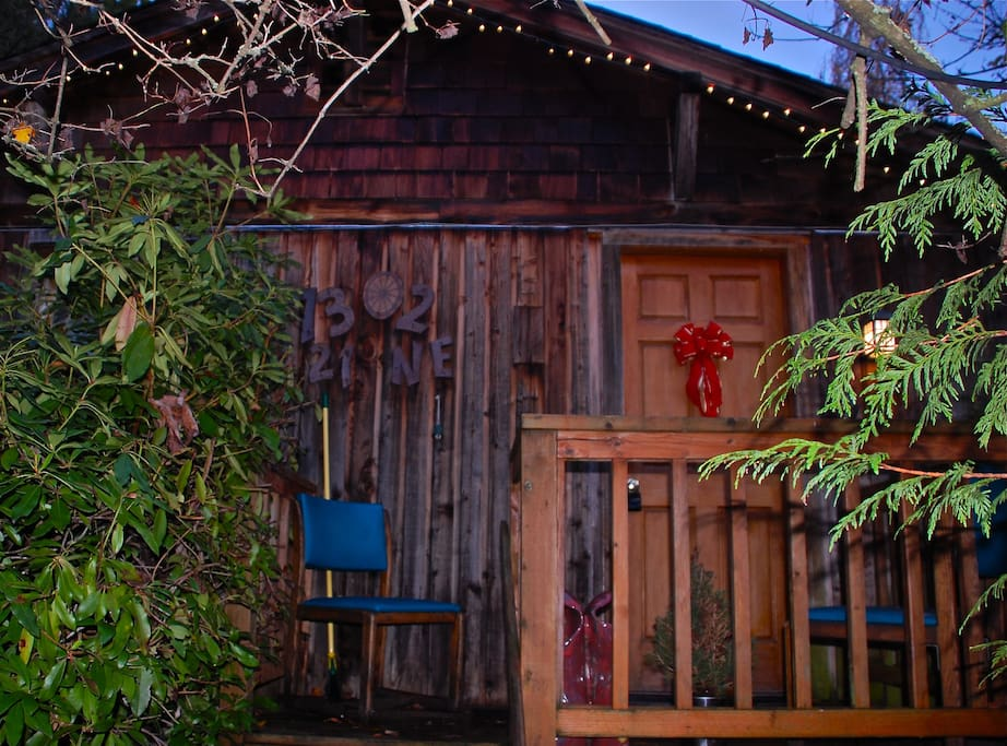 private entrance marked by red bow, 40sq ft deck w/chairs under Xmas lights