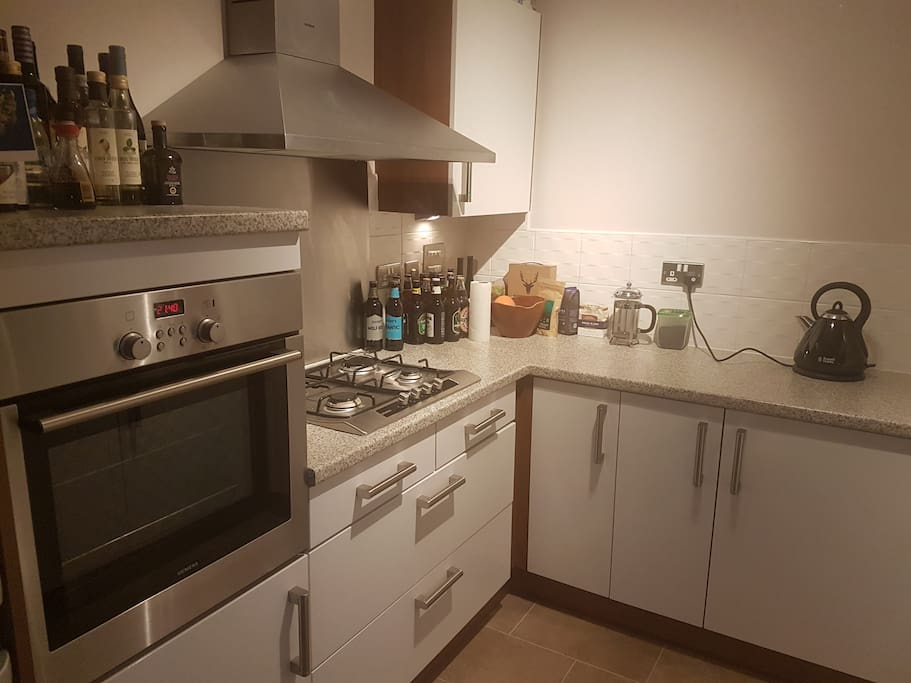 Well-equipped kitchen with fan oven and dishwasher.