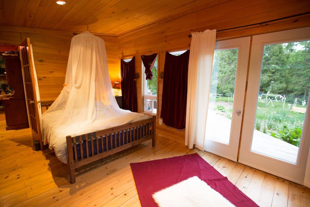 Master bedroom has double doors onto the deck