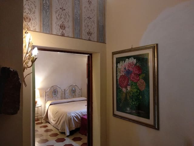 Large double bedroom with frescoes