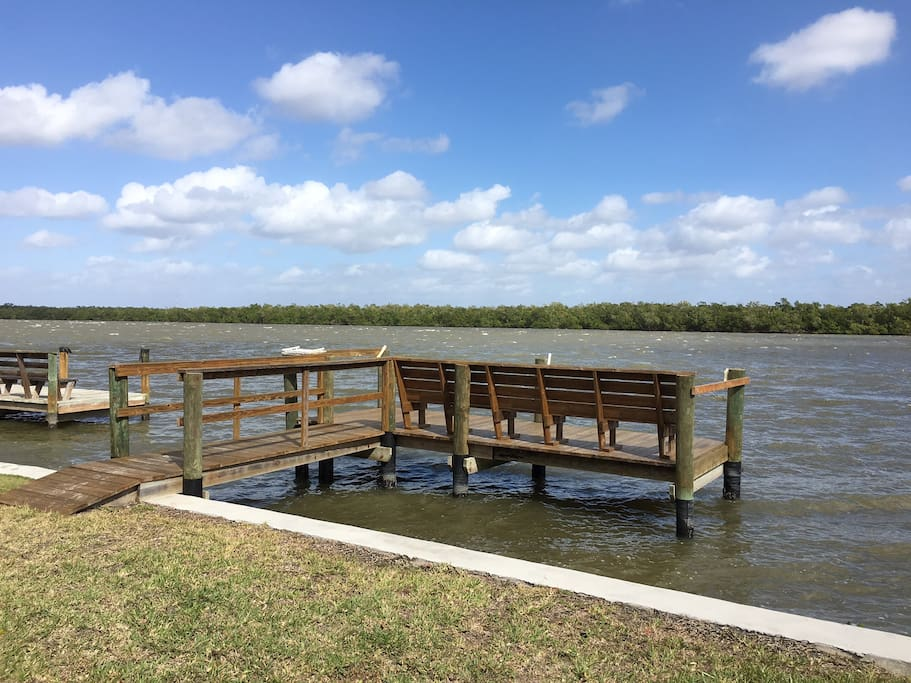 Dock at bay at end of block for fishing and boating