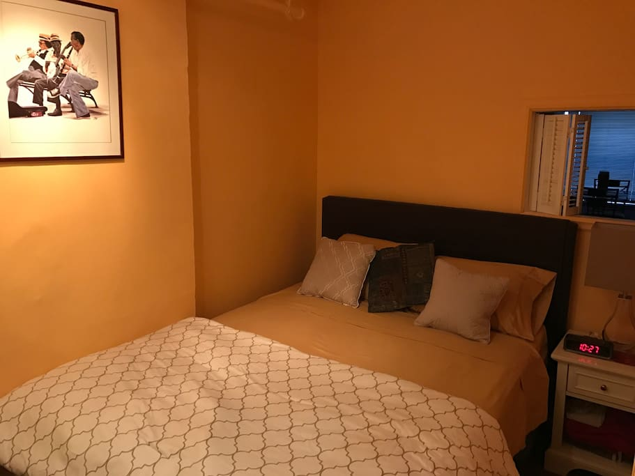 Bedroom has a Queens size bed. Cell phone charging clock radio.