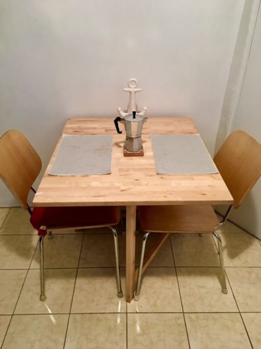 Dining Table that opens up to seat more.