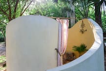Outdoor shower - with an inside like a seashell. Experience the luxury of a rainshower head shower under-the stars