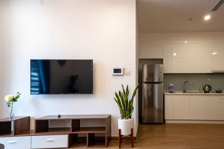 Living room connect to the kitchen (with full kitchenette) so you can cook for yourself and enjoy the meal watching TV. There are plants inside the apartment giving a fresh and natural feeling.