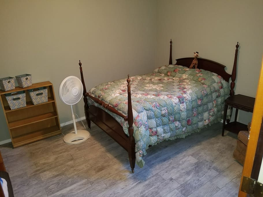 Full size bed, comfortable large room, with tile floor.