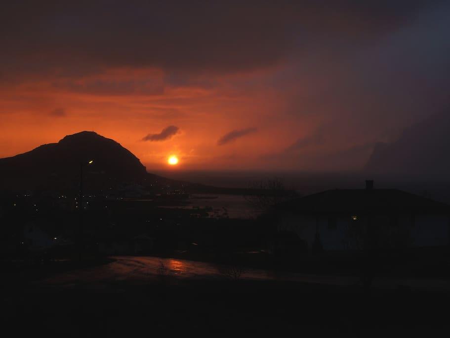 The midnight Sun and the rainfall as seen from Bjorvika.