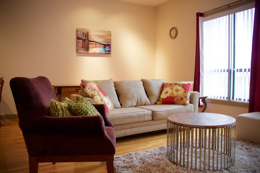 Enjoy our furnished 2-bedroom/2-bathroom apartment with Queen pull-out sofa bed, plush living room rug, and living room chair!