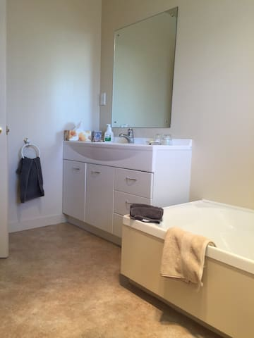 Private bathroom with bath & shower cabinet, separate toilet.