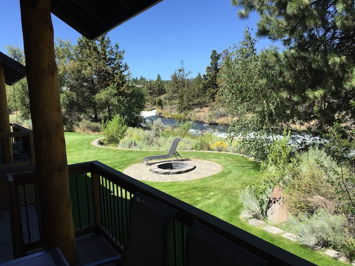 backyard view of a canal from an airbnb in bend oregon