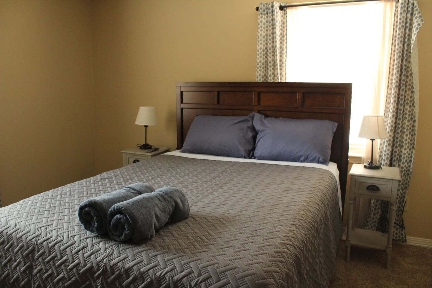 Queen size bed with brand new sheets.