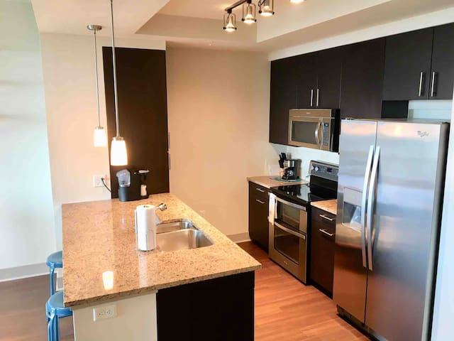 Whirlpool stainless steel appliances with dual oven.. marble backsplash in kitchen.. Stylish Leedo kitchen cabinetry.. kitchen is fully equipped with coffee maker, toaster oven, dinnerware..etc