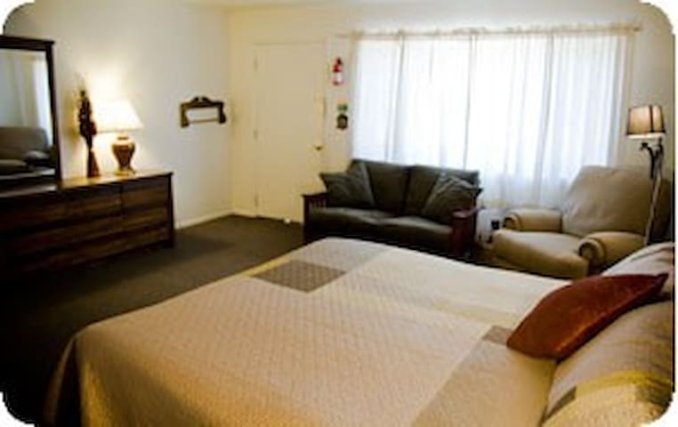 Studio has king bed with sitting area.