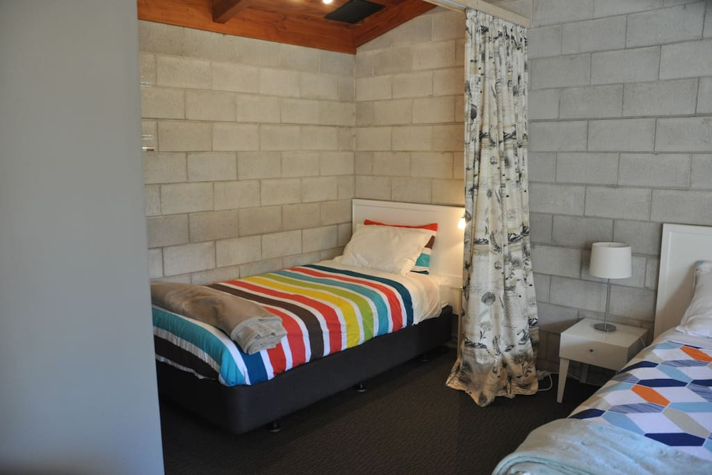King Single Bed with curtain to separate from Queen Bed