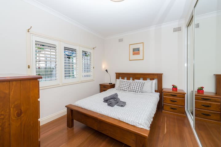 Master bedroom with comfy queen bed and big built in wardrobes