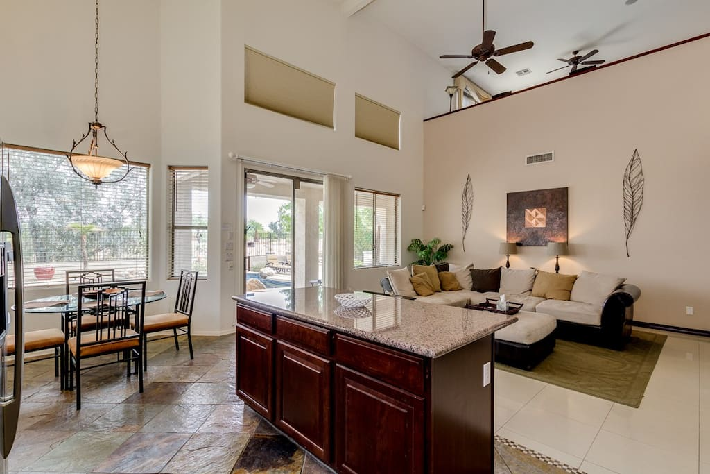 Family room, kitchen and eating area have views of backyard, pool & golf course